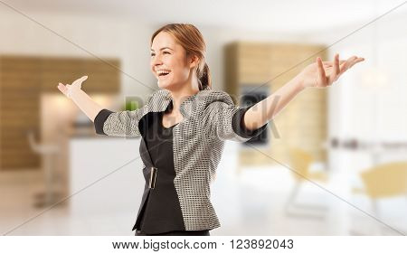 Excited real estate agent or broker with arms wide open on house indoor background poster