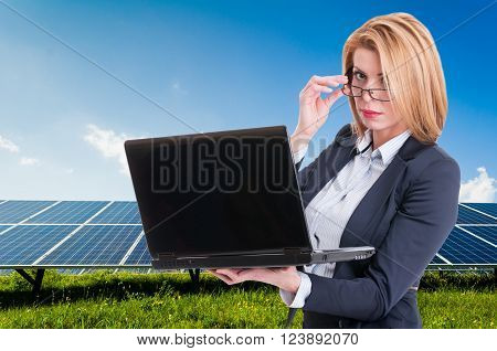 Businesswoman With Solar Power Plant In Background