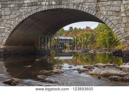 Looking beneath one of the stone arches of the Edna Dean Proctor Bridge  in Henniker New Hampshire.