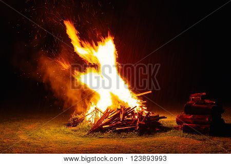 Burning camp fire in the late evening