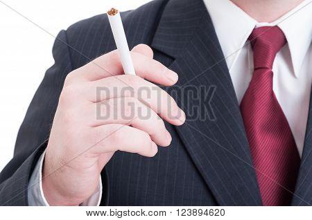 Elegant Businessman Hand Holding An Unlit Cigarette