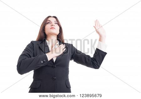Hero Shot Of Young Female Lawyer Making Oath Gesture