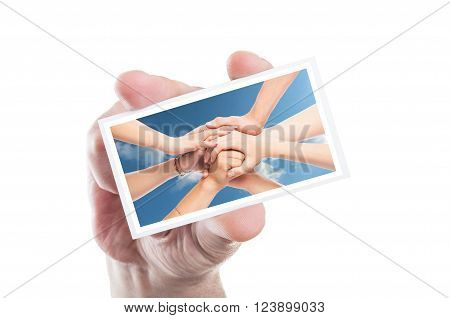 Hand holding volunteer card with joined hands background as ngo volunteering concept poster