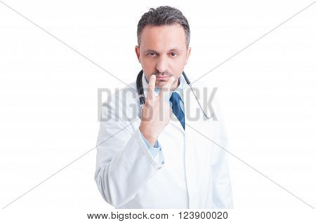 Look into my eyes and pay attention gesture made by doctor or medic isolated on white background