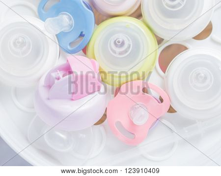 Steam sterilizer and dryer for sterilize baby accessories. Nipple teethers and milk bottles in steam sterilizer and dryer. Steam sterilizer used for sterilize baby accessories by high temperature steam. ** Note: Soft Focus at 100%, best at smaller sizes