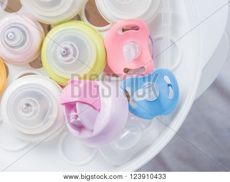 Steam sterilizer and dryer for sterilize baby accessories. Nipple teethers and milk bottles in steam sterilizer and dryer. Steam sterilizer used for sterilize baby accessories by high temperature steam.