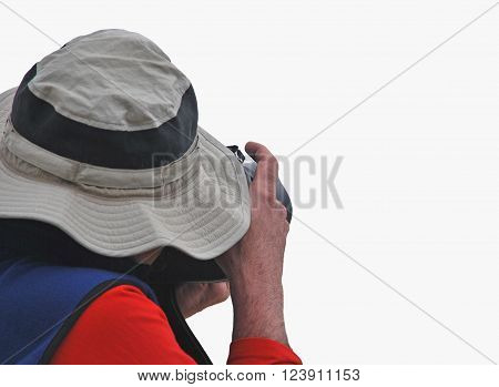 Paparazzi isolated over white. Unrecognizable photographer with a hat about to take pictures hidden under a big hat.