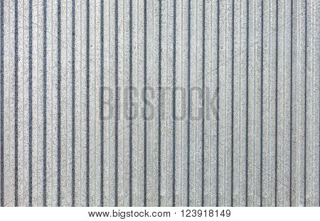 new stainless steel sheet metal galvanized iron as a fence. Galvanized sheet - Corrugated metal surface texture with copy space.