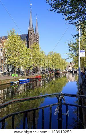 Amsterdam, Netherlands - May 5: Tris is the catholic church St. Francis Xavier near channel Singel May 5, 2013 in Amsterdam, Netherlands.