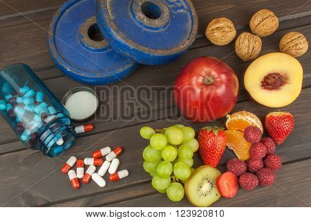 Healthy weight loss. Fruit, vitamins and sport. The concept of dietary supplements.