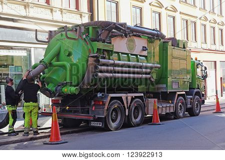 Stockholm, Sweden - March, 16, 2016: sewerage truck works on a street of Stockholm, Sweden