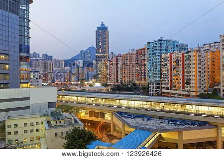 Hong Kong urban city at night , train station in public living zone