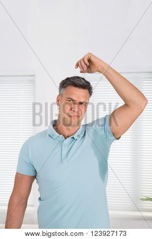 Man With Hyperhidrosis Sweating Very Badly Under Armpit At Home
