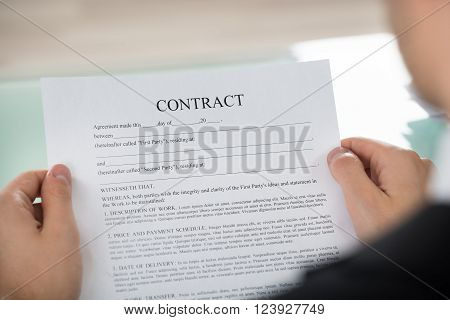Businessman Holding Contract Form
