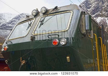 Flam valley, Norway - May 05 2013: a green train at famous Flam railway (Flamsbana) line
