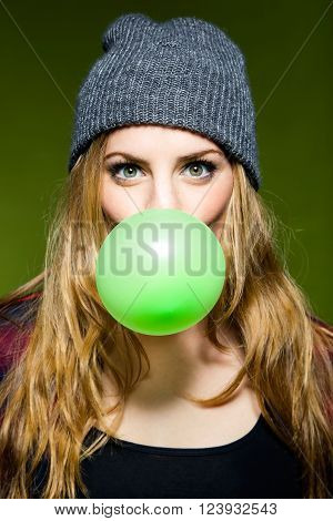 Beautiful Young Woman Blowing Green Bubblegum. Isolated.