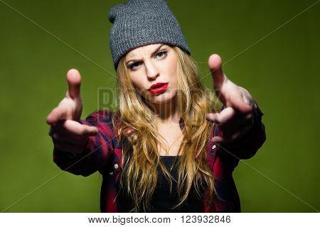 Beautiful Young Woman Pretending To Shoot Gun With Fingers.