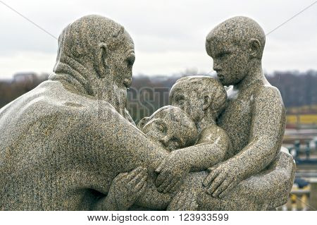 Statue of man and children by Gustav Vigeland in Frogner Park. Oslo, Norway. May 04, 2013