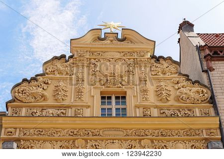 TORUN POLAND - JULY 7 2009: Gable of the house under the star a building styled with baroque ornaments on 35 Rynek Staromiejski at the old town square