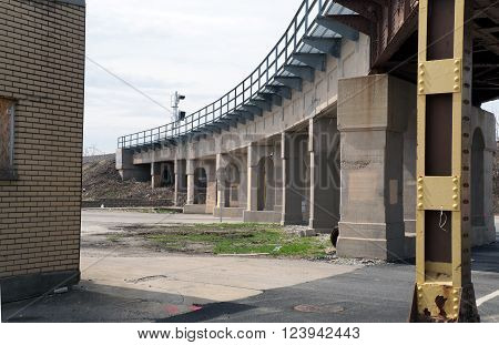 JOLIET, ILLINOIS / UNITED STATES - APRIL 12, 2015: Motorists and pedestrians may pass under a railroad bridge in downtown Joliet, Illinois.