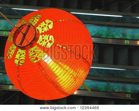 Chinese red lantern above escalator