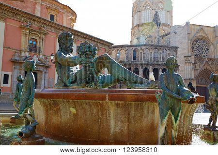 Valencia Plaza de la Virgen square and Neptune fountain statue in Spain