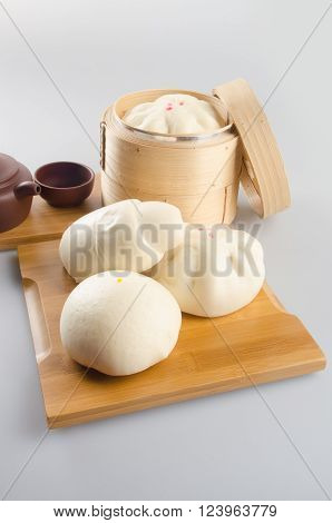 Pao Or Chinese Steamed Bread On A Background.