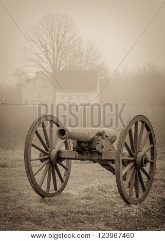 A civil war cannon in a field