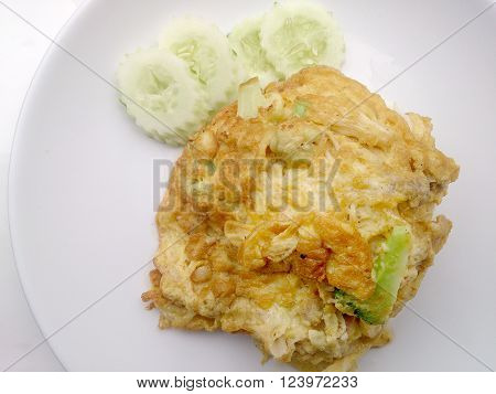 Thai-Style Omelet (Khai Jiao), Omelet with vegetables in white plate, It's popular traditional Thai style food