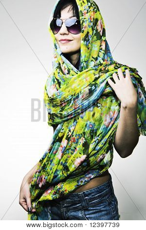 The beautiful girl in a motley scarf