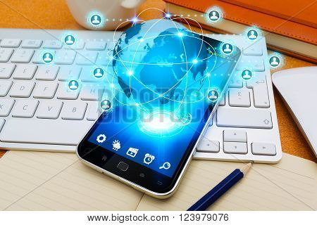 Modern mobile phone in office with social network application