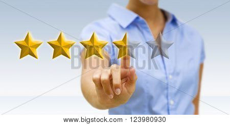 Young business woman using digital golden stars
