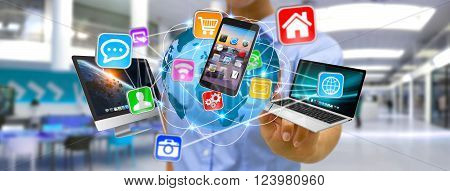 Businesswoman holding multimedia tech devices in his hand