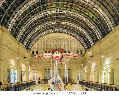 Moscow, Russia - January 05, 2016: Upper tier and the vault of the central hall of GUM in Christmas holidays