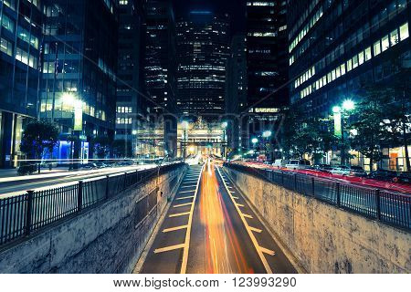 night city view with blurs of passing cars