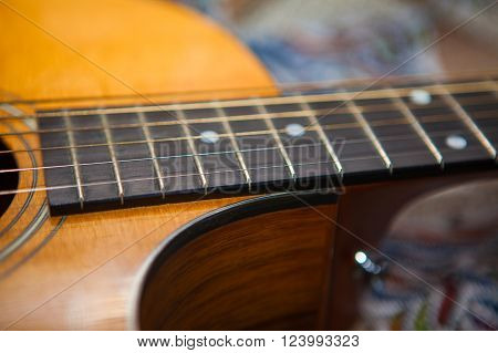 wooden body and fretboard of six strings  acoustic guitar