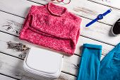 Pink sweater and white handbag. Clothing and accessories on display. Spring sale at huge discounts. New clothes for fair price. poster