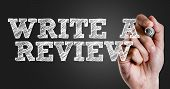 Hand writing the text: Write a Review poster