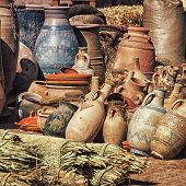 Differently sized dusty Clay pots stuck together at the village market in Moroccan town Ouarzazate poster