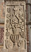 Detail from Pillars of Acre in Saint Mark Square. Ancient marble pillar with sasanid (persian) motif from St Polyeuktos byzantine church in Constantinople and brought to Venice after the 4th Crusade (1204) poster