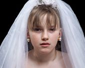 Teen girl - the bride. Portrait of a young, weeping bride. The concept of early marriages with underage children poster