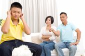 people misbehavior family and relations concept - upset or feeling guilty boy and parents at home poster