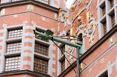 Closeup of the dragon-faced spouts of the Great Arsenal or Great Armoury in Gdansk poster