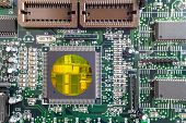 Green PCB close-up shot with cpu crystall insude poster