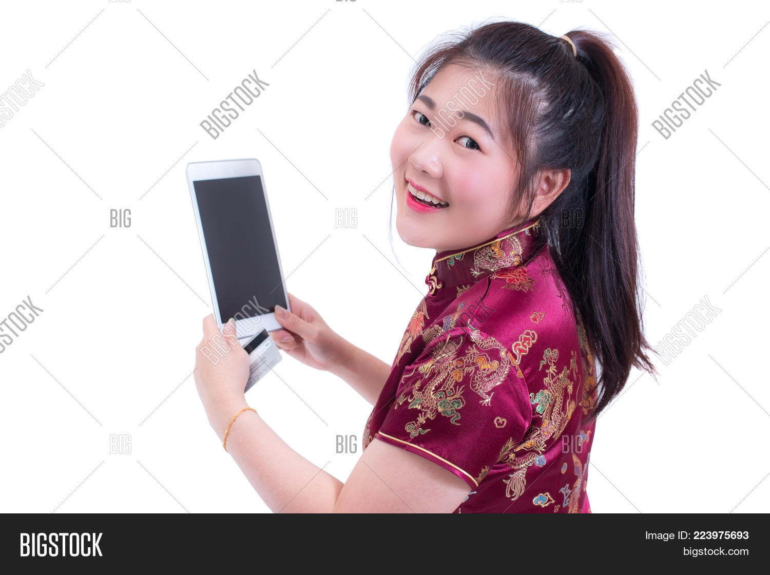 17ad578d6 Beautiful Young asian woman wear chinese dress traditional cheongsam or  qipao. Hand holding blank screen