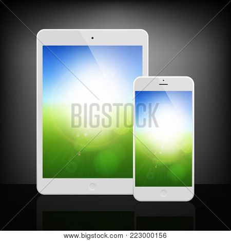 White Business Phone and Tablet with Blurry sunny landscape background on screen on dark background