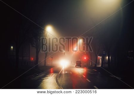 City street under the fog, night scene at the intersection.
