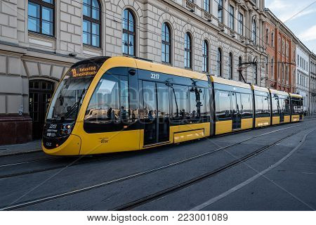 Budapest, Hungary - August 14, 2017: Scenic view of yellow tramway in Buda riverbank.