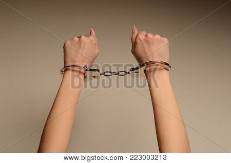 Beautiful Female Legs In Stockings And High-heeled Shoes And Hands In Handcuffs