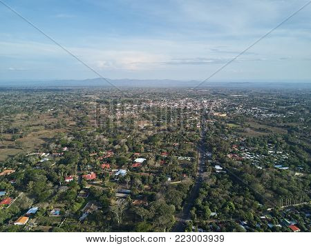 Aerial view of Diriamba city on sunny day light. Small city in valley lanscape